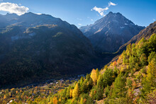 The Village Of Les Claux In Vallouise Valley With Mont Pelvoux (Ecrins National Park Massif) In The Distance In Autumn. Hautes-Alpes, Southern French Alps, France