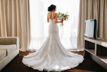 Bride In A White Dress With A Bouquet
