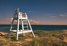 Lifeguard Chair And Sky On A Sandy Beach