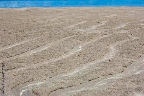 Obraz na plátně sand drawn texture on the beach and sea