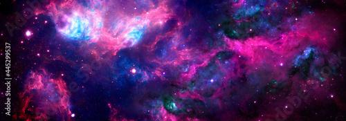 Tela Cosmic background nebula with stardust and shining stars.