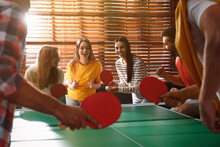 Happy Friends Playing Ping Pong Together Indoors