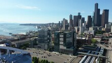 Cinematic 4K Aerial Drone Footage Of Seattle Downtown, Skyline With Skyscrapers, High-rise Office And Residential Buildings With The CenturyLink, Lumen Field Seahawks Stadium In The Foreground