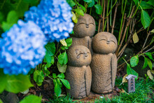 Jizo Statues And Hydrangea Flowers.