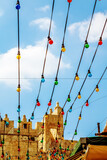 Garlands of colorful light bulbs in front of the Jaffa gate inside the old city of Jerusalem, Israel