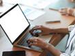 Mock up of female typing on laptop keyboard
