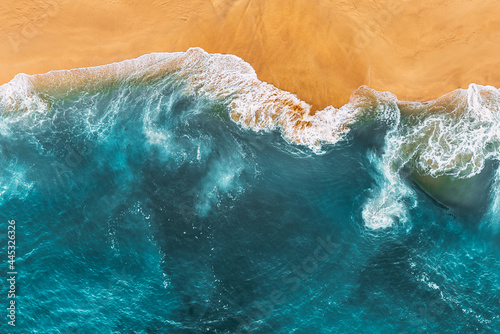Relaxing aerial beach scene, summer vacation holiday template banner. Waves surf with amazing blue ocean lagoon, sea shore, coastline. Perfect aerial drone top view. Peaceful bright beach, seaside