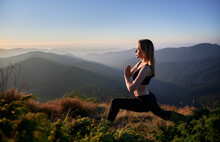 Side View Of Young Cute Woman Doing Stretching On Beautiful Mountains Background. Concept Of Yoga On Nature.
