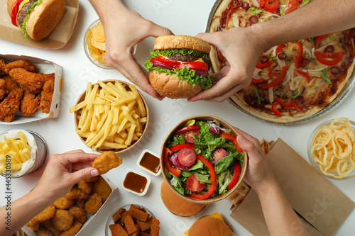 Concept of fast food on white background Fototapet
