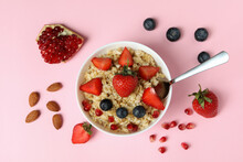 Concept Of Tasty Eating With Oatmeal On Pink Background