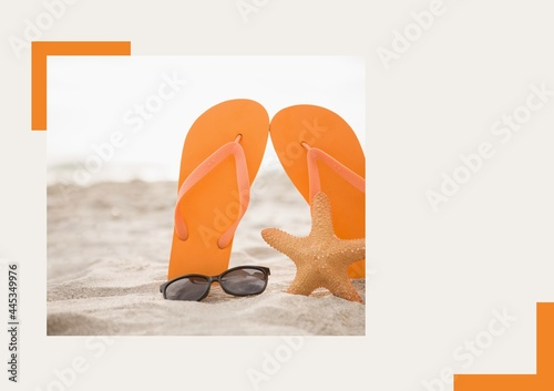 Photograph of flip flops, sunglasses and starfish at the beach against grey background