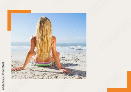 Photograph of rear woman sunbathing at the beach against grey background