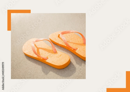 Photograph of orange flip flops at the beach against grey background
