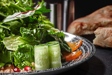 Salad With Greens, Cucumber, Persimmon, Pomegranate And Grated Walnuts