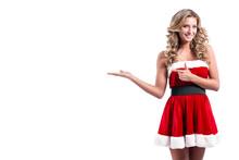 Young Beautiful Santa Girl In Short Festive Dress Fur, Long Blonde Hair, Bright Make Up, Conceptual Fashion Art.