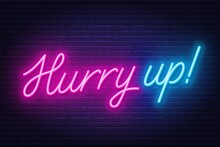 Neon Sign Hurry Up On Brick Wall Background.