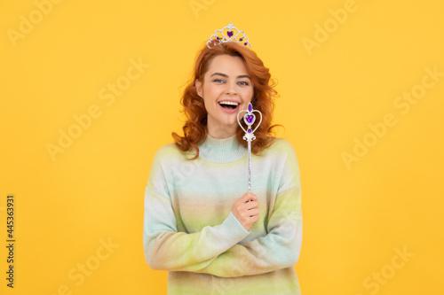 Fotografie, Obraz happy redhead woman in queen crown with magic wand, dreams come true