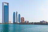 Fototapeta Konie - Abu Dhabi cityscape, skyscrapers towers