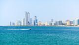 Fototapeta Konie - Abu Dhabi skyline on a sunny summer day, skyscrapers