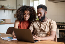 African American Couple Working On Finance Application Together