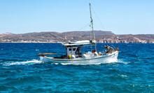 Fishing Boat Moving In Wavy Sea. Cyclades Greece