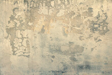 Soft Focus Of The Texture And Pattern Of A Gray Concrete Wall With A Partially Flown And Destroyed Top Layer. Background For Design And Decoration In The Grunge Style. Toned Photo With Copy Space