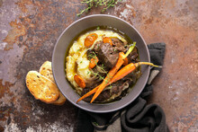 Beef Bourguignon Served In A Rustic Manner With Smashed Potatoes