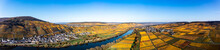 Germany, Rhineland-Palatinate, Helicopter Panorama Of Moselle River And Surrounding Vineyards In Autumn