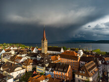 Germany, Baden Wurttemberg, Radolfzell, Aerial View Of Old Town Over Lake Constance During Thunderstorm