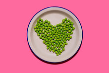 Plate Of Green Peas Arranged Into Shape Of Heart
