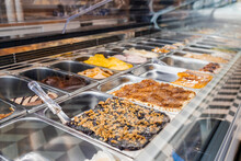 Different Flavors Of Ice Cream Displayed At Store