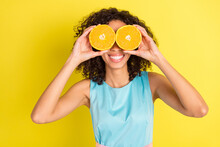 Photo Of Funky Wavy Hairdo Millennial Lady Hold Oranges Wear Blue Dress Isolated On Yellow Color Background