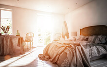 Sunlight Streaming Through Doorway Of Bedroom