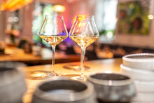 White Wine In Glass At Table In Bar