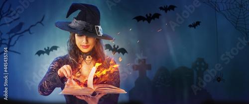 Fényképezés Halloween Witch girl with magic Book of spells portrait