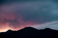 Pink And Orange Sunset Over Mountains