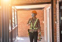 Air Conditioner Repairmen Work On Home Unit.