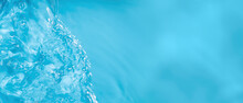 Transparent Blue Transparent Water Surface Texture With Ripples, Splashes And Bubbles. Abstract Water Wave Banner Background In Sunlight With Copy Space