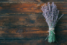 One Bouquet Of Lavender Tied With Jute Thread On A Dark Plank Table. Copy Space