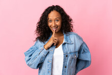 Teenager Cuban Girl Isolated On Pink Background Showing A Sign Of Silence Gesture Putting Finger In Mouth