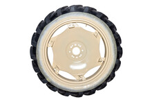 Freshly Painted Rims In A Light Color From A Farm Tractor, Isolated On A White Background With A Clipping Path.