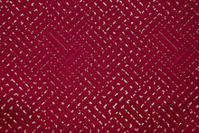 Scarlet Fabric With Gold Interspersed And Gold Stitches