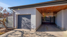 Pano Exterior Of A Garage With A Wooden Ceiling And The Sun Shines.