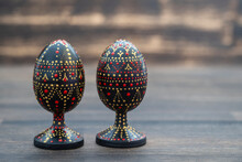 Colorful Handmade Wooden Easter Egg On A Wooden Background. Hand Painted Easter Eggs With Acrylic Paints, Handwork, Dot Painting, Closeup, Ukraine