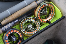 A Collection Of Fly-fishing Reels At The Ready