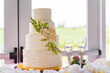 canvas print picture - Four-tier cake with two glasses on the table