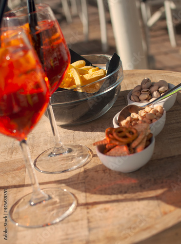 Canvas Shot of the aperitifs at the beach put on the wooden table.