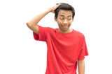 Young Indonesian guy fixing his hair with a nimble face on a white wall backgrou