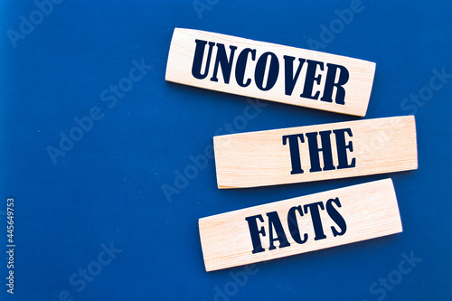 Tela Text sign showing Uncover the facts
