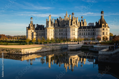 Chateau de Chambord, France reflecting in the water on a sunny day